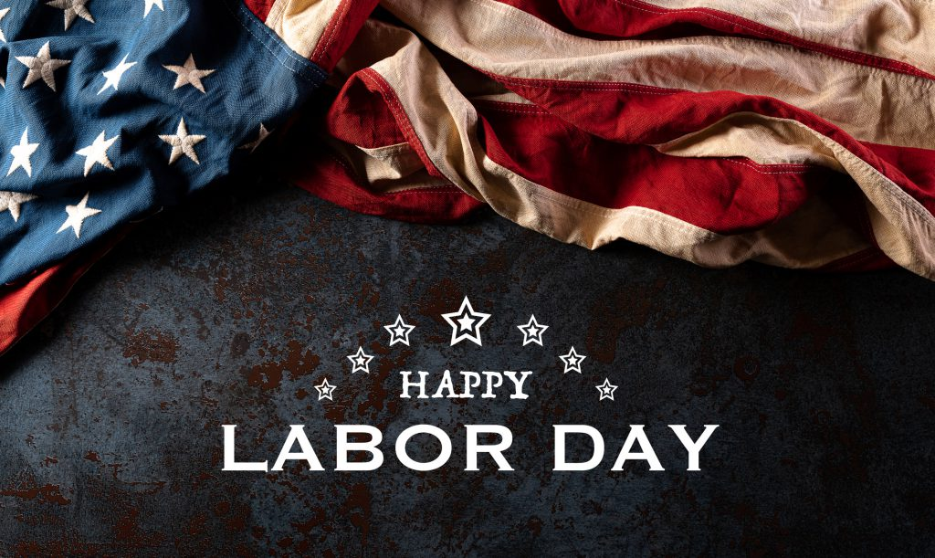 Happy labor day text with America flag over black stone texture background.